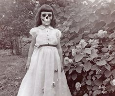 Skull face girl    http://www.etsy.com/listing/79115875/creepy-girl-with-skull-face-art-print