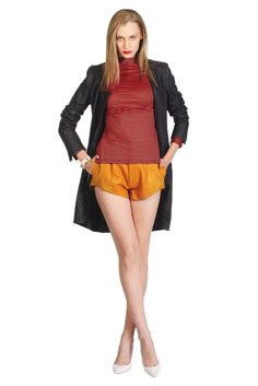Fall 2012 Trend: Gimme Some Skin  (Cerre's leather trench and Titania Inglis' leather shorts worn with Twenty8Twelve's cotton spandex top. Manolo Blahnik pumps.)