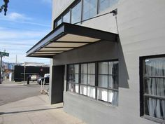 Cantilevered awnings are the modern sleek design of todays ...