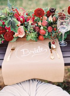 Kraft paper place settings. Love the brown kraft paper for the guest of honor. Flower arrangement is incredible