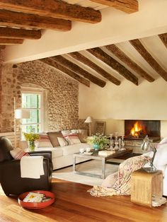old rustic barn home in Spain...love the mix of stone, plaster and beams. (Less beams though)
