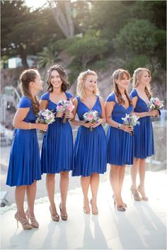 Royal blue bridesmaids dresses | I don't like thecolor, but the dresses themselves are pretty | Image by Caught the Light, see more http://goo.gl/kOgn3D