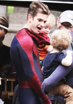 Andrew Garfield with a child.. why is he perf?