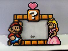 Super Mario and Princess Peach Photo Frame - Perler Beads Perler Beads, Hama Beads Mario, Hamma Beads 3d, Perler Bead Art, Fuse Beads, Hama Mario, Perler Bead Designs, Super Mario, Mario And Princess Peach