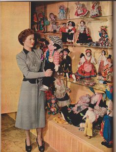 1949 Shirley Temple and some of her doll collection