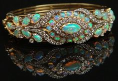 Most beautiful opal diamond ring I've ever seen! Mid Century hand made opal, to carats diamond, yellow gold & platinum bangle bracelet Opal Jewelry, Sea Glass Jewelry, Fine Jewelry, Jewlery, Opal Necklace, Boho Jewelry, Diamond Bracelets, Bangle Bracelets, Bangles