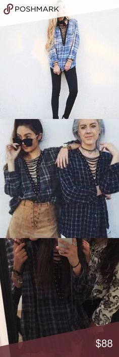 LF furst of a kind Lace up flannel blue black and gray ; super cozy and comfortable; can be worn as a shirt or dress; first two pics r just models; last two are of the actual top! Only worn twice! Perfect condition; no longer sell in stores LF Sweaters