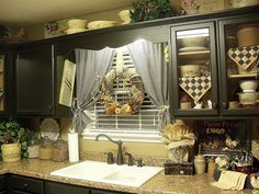 love the checked napkins in the shelves - love the entire look