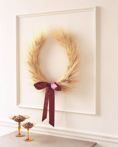 Wheat represents bounty and wealth; the horseshoe shape is good luck. Let this decoration work its powers at your ceremony or reception venue.