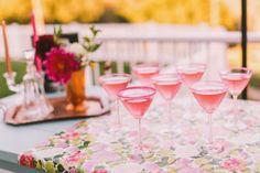 pink sugar-rimmed martinis on pink and green floral runner  | lovelyfest event design