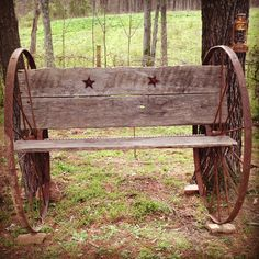 Homemade antique bench out of wagon wheels and barn wood pieces . Great outside decor
