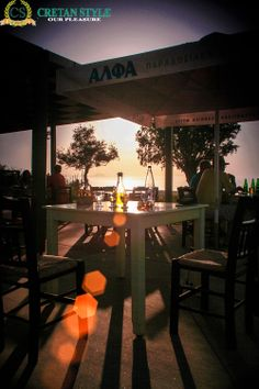 sun through bottles at taverna eleven by the sea...
