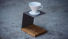 If your main method of making coffee is with a pour-over brewer like the Hario V60, it should have a special home of its own on your countertop. The Pour-Over Stand by JM&Sons fits the bill. It's a simple-but-stylish metal stand with a base made from salvaged barn wood, and fits any pour-over dripper up to 2.5″ in diameter. The stand by…