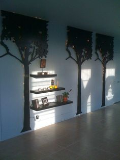 Nola Clutter Busters Designs: yoga studio- custom cut wooden trees with twinkle lights behind.