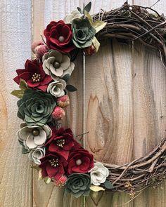 Pretty felt flowers and succulents on a grapevine wreath.  #etsyshop