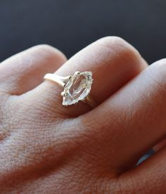 Raw diamond ring, the stone is completely natural, uncut, and fresh from the earth. The setting is solid 925 sterling silver. Ring band size is: 9