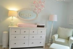 Nursery mirror above change table, lamps and nursing chair - Via http://emilyanninteriors.blogspot.com.au/