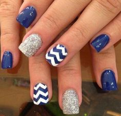 If you were looking for a blue version of the nail design above; then this is your answer!  Coated in electric blue and white polish, you are sure to have electrifying and beautiful nails ahead of you. The nails are matted in electric blue polish and topped with white zigzag lines; the other nails are coated with matte blue and filled with silver glitter.