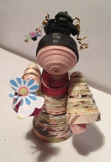 Paper quilling doll. 2 inches high.  Made for my nephew's Jr K teacher