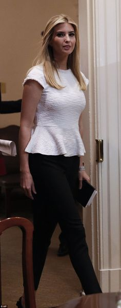 Elegant outfit  Ivanka paired her summery white peplum top with black dress  pants Ivanka Marie cf6347d684