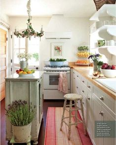 Bright kitchen - perfect for small spaces. I love the little touch of distressed elements that make it look homey {cottage kitchen with wood counters, open shelves, beautiful distressed island and stool, wooden door, fancy