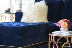 Navy blue tufted sofa