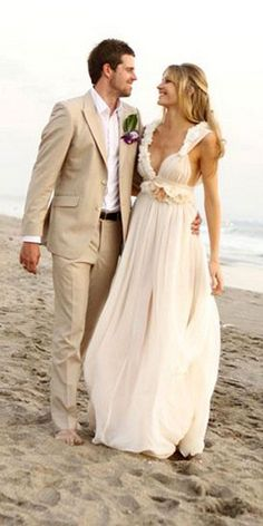 gorgeous attire, for the bride and groom.  Love beach weddings :)