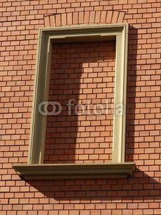 Rahmen eines zugemauerten Fenster in einer Backsteinfassade in Wettenberg Krofdorf-Gleiberg im Landkreis Gießen in Hessen