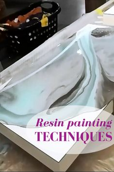 Resin painting techniques.  Learn how to use several colors to 'dirty pour' resin. #artpainting