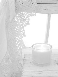 White is a candle on a window sill.