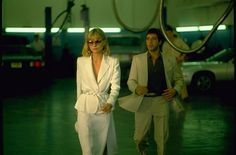 Scarface is up there with Clueless in terms of scene after scene of great fashion. Michelle Pfeiffer as Elvira in this amazing, elegant white suit case in point.