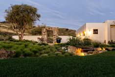 """From lush gardens to crystal-clear pools and hardscapes that add style underfoot, these hip hangouts turn the backyard into your favorite """"room"""" of the house. From the experts at HGTV.com."""