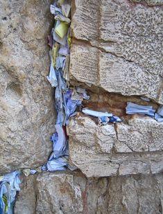 prayers in the cracks at the western wall (wailing wall) Jerusalem