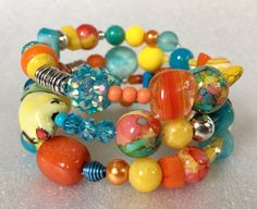 Orange/turquoise/yellow bracelet memory wire by onechickstudio