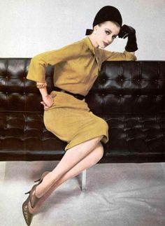 Jersey dress Pierre Balmain. Love the leather sofa by Mobilier International! L'Officiel 1961
