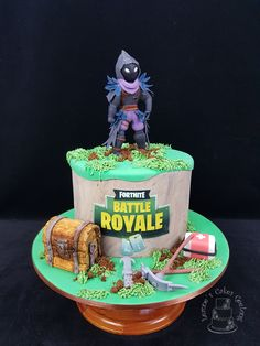 "Fortnite Battle Royale: The brief for this little cake was to have the Raven character on top with grass and ""make it cool"". www.facebook.com/cakesbyleannerhodes"