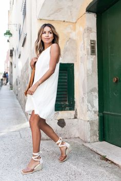 Julie of Sincerely Jules wearing her Soludos tan Tall Leather Wedges around the streets of Positano