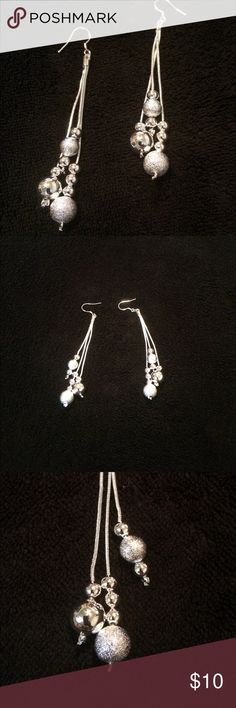 Sterling silver dangle earrings Earrings are three strands with silver beads on each strand. Some beads are textured and others are polished. Earrings are 3 inches long. Brand new, never worn. I bought two pair, one to give as a gift and never did. NWOT Jewelry Earrings