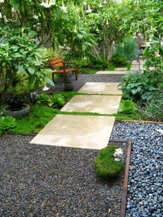 Square concrete stepping stones, gravel, pebbles. Great mix for walkway and cost effective design for garden or yard
