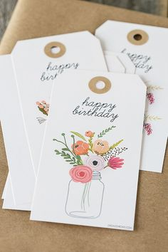 Floral birthday gift tags on kraft paper