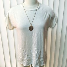 """Ann Taylor LOFT Embroidered Tee Ann Taylor LOFT Embroidered Tee. This top is super feminine and comfortable! Delicate embroidered hem and rolled sleeves with a loose fit. Linen/cotton blend is SUPER soft and airy.  Color is off-white/cream.  Women's size Petite Medium. Length: 23.5"""". Shoulder width: 21"""". LOFT Tops Tees - Short Sleeve"""