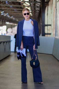 13 ways to wear a suit this summer: Elyse Knowles' navy pantsuit could read workwear save for a fitted white tank to up the cool girl appeal.