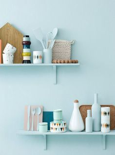 Painted shelves, painted walls to match. Do this? Or paint the shelves white so they stand out from the walls?