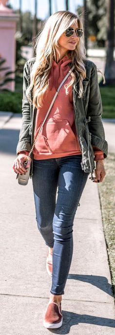 Military Jacket / Coral Sweater / Navy Skinny Jeans / Brown Sneakers                                                                             Source