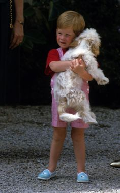 Prince Harry cuddled a dog during a trip to Majorca, Spain, in 1987.