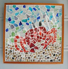 """Walk with Me"" Handcrafted mosaic of a fiddler crab made with sea glass, ceramic and stones. This item has been sold."