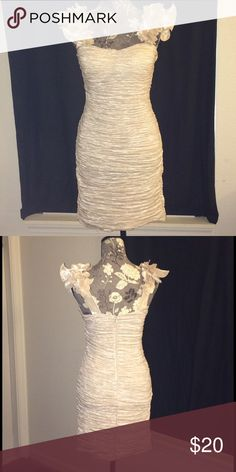 NWOT🎉Cream/Metallic Floral Strap Dress👗💐 This is a cute little dress perfect for New Years! Its a perfect color for this dress with ruching along both sides of this dress, floral details along the straps. There is a zipper closure along the back with a hook and eye at the top.  🔹I will add more photos with a close up photo of the fabric and dress details🔹 Forever 21 Dresses