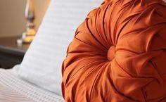 Affinity Corporate Living- orange pillow