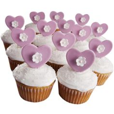 Cupcake Courtship - Flower-centered, pearl-dusted fondant hearts and a liberal sprinkling of white Sparkling Sugars turn cupcakes baked in our Standard Muffin Pan extraordinary!