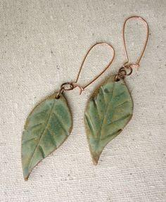 stoneware leaf earrings in earthy avocado green on kidney earwires.